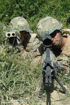 Royal Marines from 40 Commando observe the area surrounding Sangin of Afghanistan with the newly introduced L129A1 or Sharpshooter 7.62mm rifle.    Both Marines are wearing newly issued Mk7 helmets and Mk8 Osprey body armour and are dressed in Multi Terrain Pattern (MTP) camouflage.