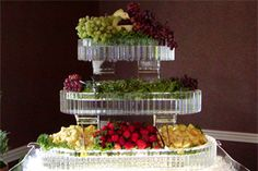 Make food trays of ice to keep food cold for serving. Brilliant! This is an ice sculpture but could make more simple by freezing water in containers or trays.