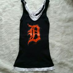 Detroit tigers jeweled tank top Worn once perfect condition Detroit tigers tank. Hidden double tank effect. Not actually a double shirt but looks like it. Size L but would fit a M too. Tops Tank Tops