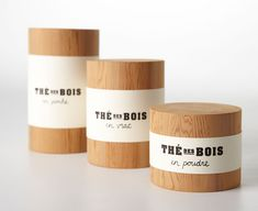 Minimal black type on a white label wrapped around beautiful natural wooden cylinder boxes. #packaging