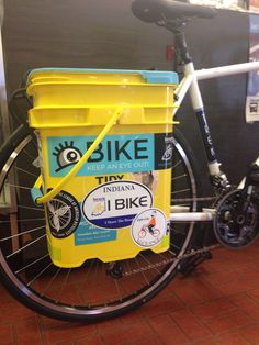 Reuse those kitty litter buckets. They make great panniers that you can customize with fun stickers.