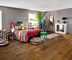 It is scientifically proven that the use of colours in your home can upgrade your emotional health. So don't be afraid to use them and find an addition, like a natural hard wood floor to keep the balance.  www.kahrs.com www.woodcore.ro