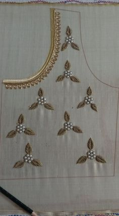 Aari embroidery on a bridal blouse. Filled with Zardosi and semi bead. Necklace design on neck portion Zardosi Embroidery, Embroidery On Kurtis, Kurti Embroidery Design, Hand Embroidery Dress, Bead Embroidery Patterns, Flower Embroidery Designs, Beaded Embroidery, Embroidery Letters, Embroidery Stitches