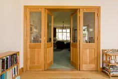 Bespoke European oak room dividing doors with clear glass windows