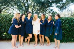 bridesmaids in navy robes / photo: sophantheam.com