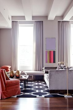 The Colors of the Year, Rose Quartz and Serenity, mix and match in this traditional-meets-modern living room.