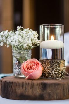 Simple table arrangement with peach rose and babies breath. by victoriangardens.com
