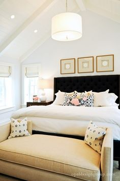 seat in front w simple, cool pillows. 3 simple pieces above bed. guest room