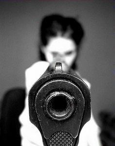 It is pointed at you, i.e., anyone who would harm her, her children or her freedoms!!! The 2nd amendment is for all of We the People!