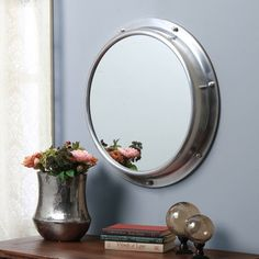 @Overstock - Aluminum Porthole Round Mirror - This round mirror is styled after a porthole, excellent for nautical themed homes or just a unique accent piece. The brushed aluminum body includes a single screw hanger for easy installation.  http://www.overstock.com/Worldstock-Fair-Trade/Aluminum-Porthole-Round-Mirror/9253820/product.html?CID=214117 $99.99