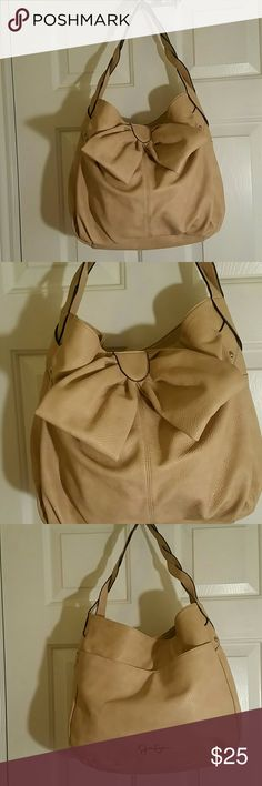 JESSICA SIMPSON BOW PURSE Adorable good size Jessica Simpson bow purse.  Cream color with large bow accent on front, back has large outside pocket. Woven style strap. Inside large open compartment with a couple small side ones for phone etc. This bag would make a great addition to your summer wardrobe. In wonderful condition with no stains, holes or tears inside or out. Jessica Simpson Bags Hobos