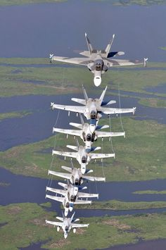 Eight Hornets assigned the River Rattlers, Strike Fighter Squadron fly in a column formation over southern Louisiana's wetlands during a photo exercise. VFA 204 is stationed on Naval Air Station Joint Reserve Base, New Orleans. Photo by John P. Military Jets, Military Aircraft, Fighter Aircraft, Fighter Jets, Formation Photo, Jet Plane, War Machine, Us Navy, Air Force