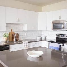 White Flat Front Cabinets With Grey Quartz Countertops, Transitional,  Kitchen