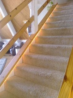 Rope light on the stairs - good idea for the basement stairs!