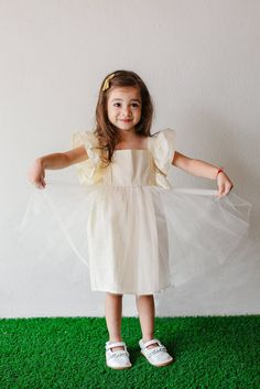 Rebecca Dress, with exaggerated flutter sleeves and tulle skirt. The perfect birthday party dress or flower girl dress.  100% medium weight cotton. Runs true to size. Only from cuteheads.