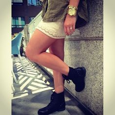 Black boots paired with a white, lace dress and an olive jacket. Add a statement watch for some fun.