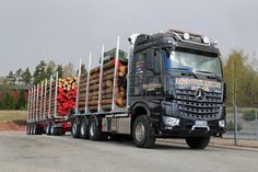 SALO, FINLAND - MAY 2, 2014 Mercedes-Benz Arocs 3263 LK 8x4 timber truck In addition to being extremely environmental friendly, MB Arocs boasts three special attributes power, efficiency, and robustness