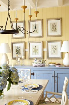 "Paint color: Walls: Mushroom Cap by Benjamin Moore. Ceiling and trim paint: White Dove"" also by Benjamin Moore. The exposed white beams and beaded-board paneling are perfect for a sunroom or breakfast room. Yellow Dining Room, Yellow Kitchen Walls, Deco Champetre, Lake Cottage, Lakeside Cottage, Yellow Cottage, Painting Trim, Interior Paint Colors, Room Interior"