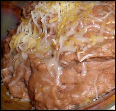 My sister-in-law who was born and raised in Mexico City shared this recipe for sprucing up canned refried beans. They taste like youve been cooking them for hours.
