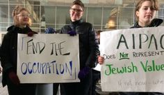 Protesters hold signs and protest against Israeli occupation outside of the AIPAC conference, March 26, 2017.