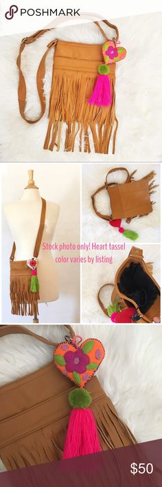 Handmade Leather Fringe Boho Crossbody Bag Purse  Shop My Travels  Get Festival ready with this super cute leather fringe purse. Purse is handmade out of recycled leather in Mexico. Fringe strips size vary on Purse due to its handmade nature. One of a kind! 9x6 with adjustable strap. Vacation cross body resort bag, music festival. Offers welcome Vida Magika Bags