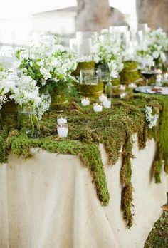 Moss Décor Ideas for a Nature Inspired Wedding- since considering an outside wedding why not continue the theme inside at the reception area?!