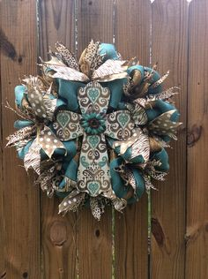 A personal favorite from my Etsy shop https://www.etsy.com/listing/294866765/cross-burlap-door-wreath