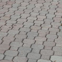 Weeds growing between interlocking pavers can be a problem for homeowners.