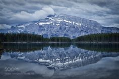 Majestic Rundle by claragamito  trees canada landscape lake winter reflection cloudy snow mountain moody pine alberta rockies nation