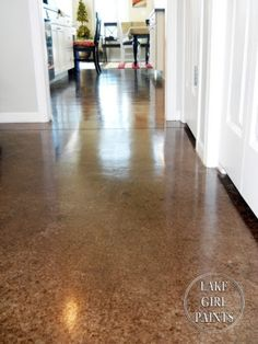 Many types of finishes for a concrete floor.  Pulling up my carpet and considering staining.