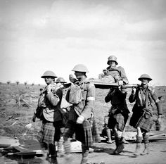 WWI, 21 Sept South African Scottish troops carrying a wounded German on a stretcher during the Battle of the Menin Road Ridge. © IWM (Q Troops, Soldiers, Battle Of Passchendaele, Highlanders, Lest We Forget, British Army, Wwi, Hats For Men, Diorama