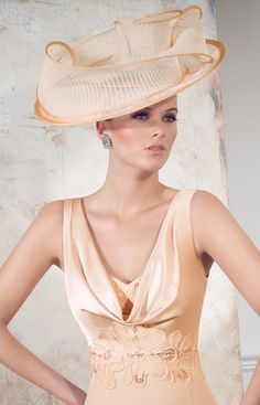 An adorable wedding guest dress from Veni Infantino by Ronald Joyce.