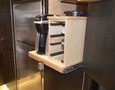 The EarthRoamer we toured had a variety of upgrades, including this slide-out Keurig (Photo: C.C. Weiss/Gizmag)
