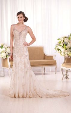 Glamorous Lavish satin sheath wedding gown from Essense of Australia features Diamante beading, lace shoulder straps, and a lace-illusion back.