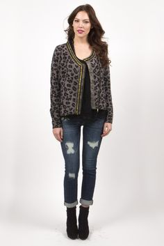 Stay warm and unleash your wild side in this chain detail leopard print cardigan by Prima Collection!  Fit is loose featuring gold chain detail on trim, crossover gold zipper and two front pockets.  Made of an angora blend, which makes this super soft and warm!!  Model is wearing size small.  Shown paired with our Elley Tank in Black, with Basic Black Tank Underneath and Distressed Rolled Up Skinny Jean - Medium Wash by Eunina Jeans