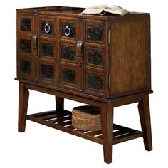 Corral art supplies in the study or store out-the-door essentials in the foyer with this rustic cabinet, showcasing 4 doors, bucked belt accents, and a dark ...