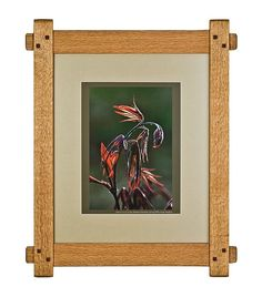 Picture frames in the Arts and Crafts style are traditionally made using mortise and tenon corner joints which are held together with square hardwood pegs, assuring that the frame will hold together for a very long time, very possibly for generations.