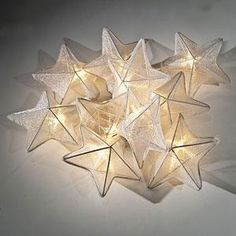 White Organza Star String Lights - Deck out your deck (or patio or living room) with these softly illuminating organza star lights.
