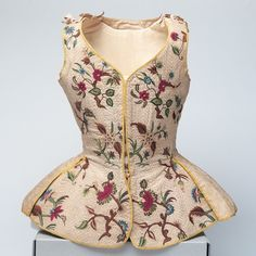 Waistcoat, ca. first half of the 18th century    Linen and silk with polychrome embroidery    English