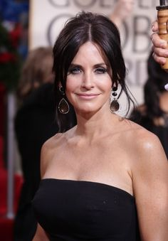 Courtney Cox Arquettes elegant updo hairstyle