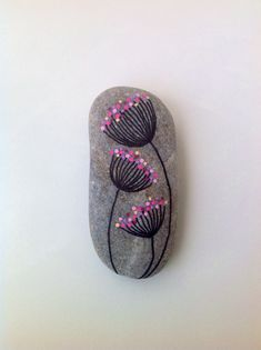 Easy Paint Rock For Try at Home (Stone Art & Rock Painting Ideas) Dandelions on my way rock–mine would NOT be pink, but it's cute. Pebble Painting, Dot Painting, Pebble Art, Stone Painting, Rock Painting Ideas Easy, Rock Painting Designs, Rock Painting Patterns, Stone Crafts, Rock Crafts
