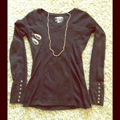 Not your bland black, warm thermal top! Check out the cute embellishment in these sleeves! Fitted, black, v-neck, soft & warm thermal top.  Always from a smoke free home. Pair this with the Coach bag and the great O'Neill jeans in my closet, and your ready to step out looking great! Tops