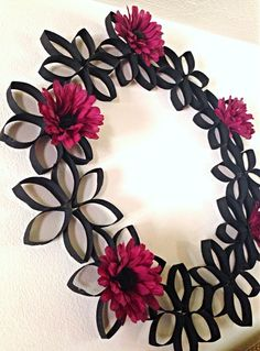 DIY wreath, cut and stapled toilet paper rolls then spray painted