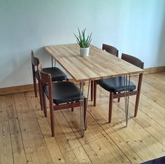 Our Scandinavian style dining table I made with an IKEA Gerton tabletop and hairpin legs from ebay. 60's design chairs.
