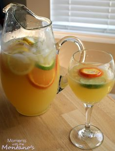 Pineapple sangria!! 1 Large Can of Pineapple Juice I bottle of white wine (your choice) 1 each: Orange, Lemon, Lime. Sprite Soda 1 shot of Triple Sec (optional) 2 tablespoons of sugar