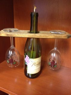 These were Wine Bottle Candle centerpieces we used at our Foundation's wine tasting event!  One of our friends painted the bottle and glasses and her husband made the glass holder!