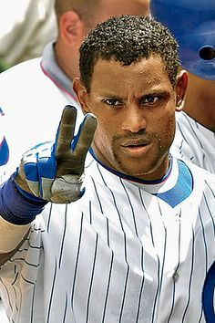 Sammy Sosa. Still my childhood hero, even though he defs was on steroids. Extremely disappointing... but he's the reason I ran to first doing the peace gesture during practice. And I still love him. <3