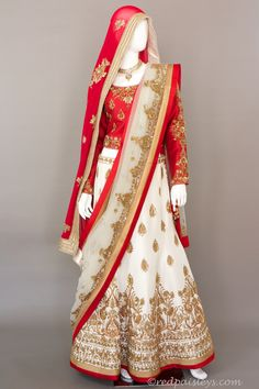 "Raw Silk lehenga and choli with antique gold zardosi work. Embellished with sequins, pearl and beads. Off white embellished Net dupatta. Fabric : Silk and Net Blouse Size : 38-40 Skirt Length : 44"" De"