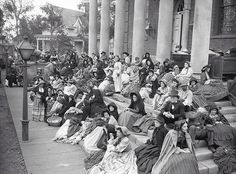 Extras are seen gathered on the steps of a set for 'Gone With The Wind' (1939)