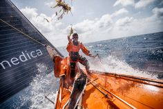 April 29, 2015. Leg 6 to Newport onboard Team Alvimedica. Day 10. True tradewind sailing in 20-25 knots and warm tropical water has everyone smiling, despite occupying the rear of the fleet. Nick Dana hucks a clump of sargasso weed from the garden of it on the bow